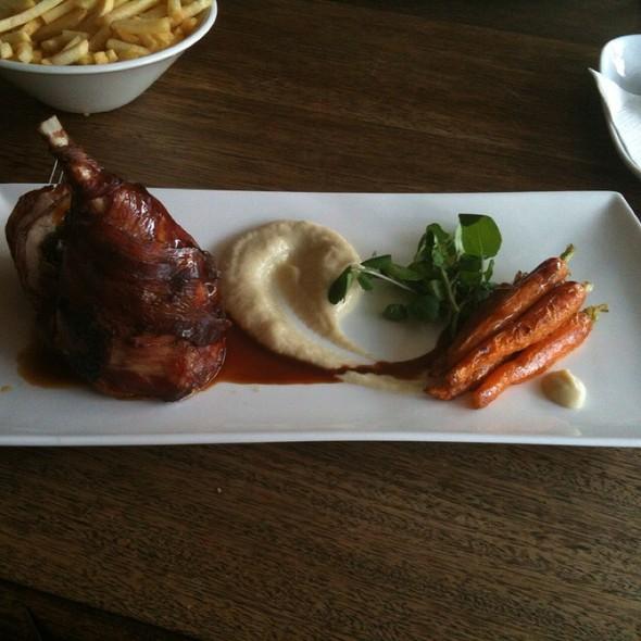 Pancetta Wrapped Rabbit Leg Stuffed With Prunes And Apple Carrots Jerusalem Artichoke Puree At Livingroom Restaurant Cafe