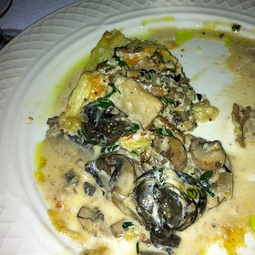 Escargot With Onions, Mushrooms And A Cognac Cream Sauce