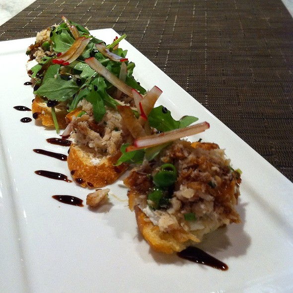 smoked trout bruschetta with peas, sweet potato, goat cheese, arugula, and aged balsamic @ One Flew South