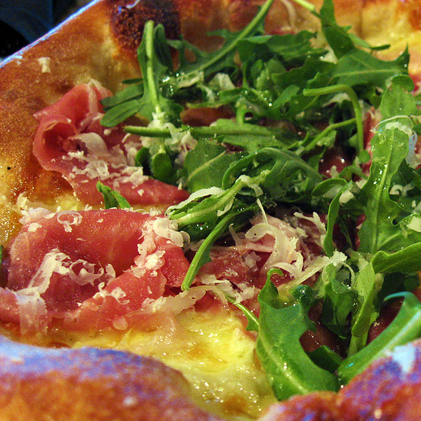 Prosciutto di Parma, Mozzarella and Arugula Pizza (close up) @ Phoenecia LLC