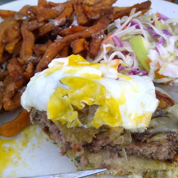 Burger Special with carmelized onions, fried egg, cheddar cheese, maple smoked bacon on a sour cream and chive biscuit @ Sabrina's Cafe
