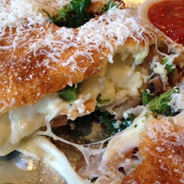 Broccoli Rabe Sausage Calzone @ Piesanos