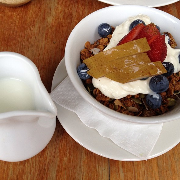 Burnt Fig Muesli With Poached Pears, Strawberry And Yoghurt With Milk On The Side