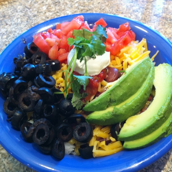 cafe yumm Deluxe toppings served with all yumm bowls : shredded tillamook cheddar cheese, diced tomato, fresh avocado slices, sour cream, black olives, and fresh cilantro.