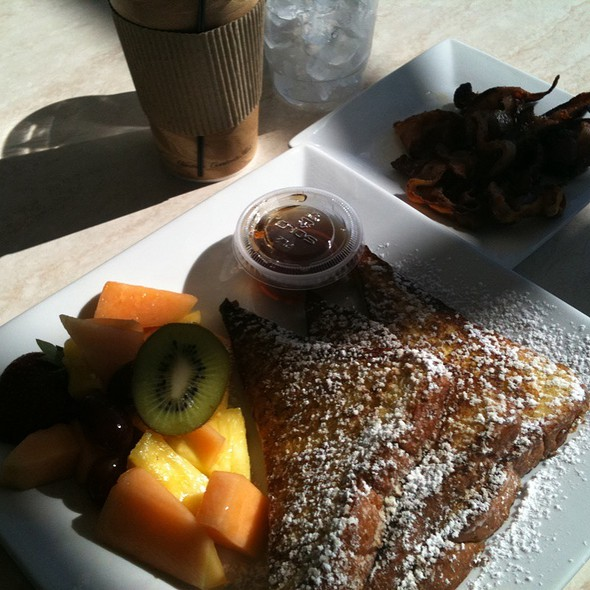 French Toast With Fresh Fruit And Side Of Crispy Bacon @ La Provence Artisanal French Bakery And Cafe