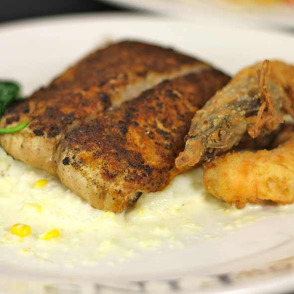 Blackened Redfish with crispy shrimp, spinach, mashed potatoes, roasted corn butter, chili hollandaise    @ GW Fins