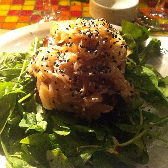 Phylo Wrapped Morbier Cheese With Onion Jam And Green Leaves @ Dada Bistro
