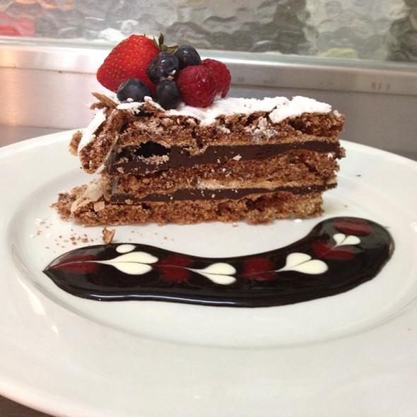 Hazelnut And Chocolate Torte With Choc Sauce And Fresh Berries @ Porterhouse Bistro