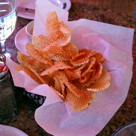 Gaufrtte Potato Chips With Blue Cheese Dip .