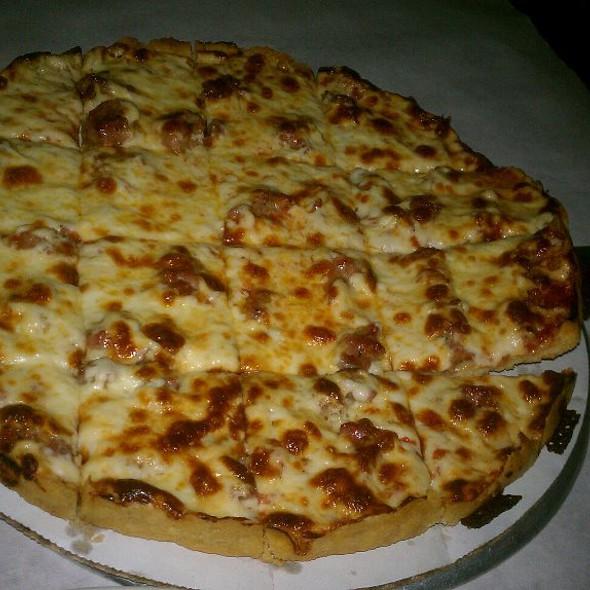 Thin Crust Sausage pizza @ Pizano's Pizza & Pasta