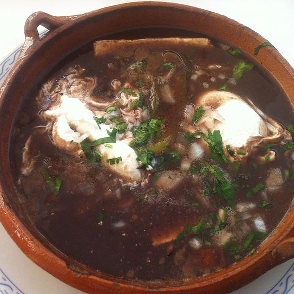 Poached Eggs Soaked In Black Beans @ El Cardenal, Av. De La Paz