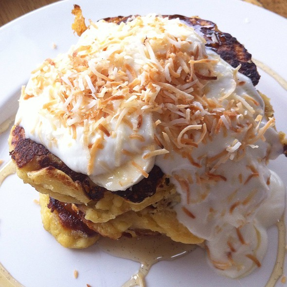 Ricotta Pancakes With Banana, Coconut, Vanilla Bean Syrup And Honey Yoghurt. @ Milkwood