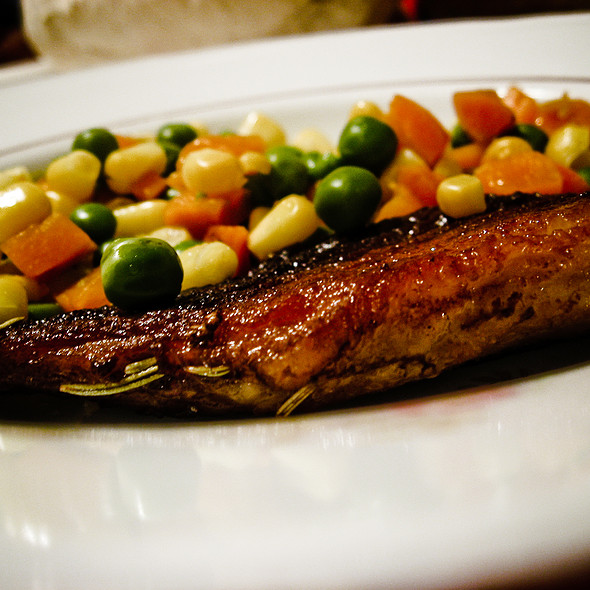 Pork chop with boiled peas, corn and carrots @ Home