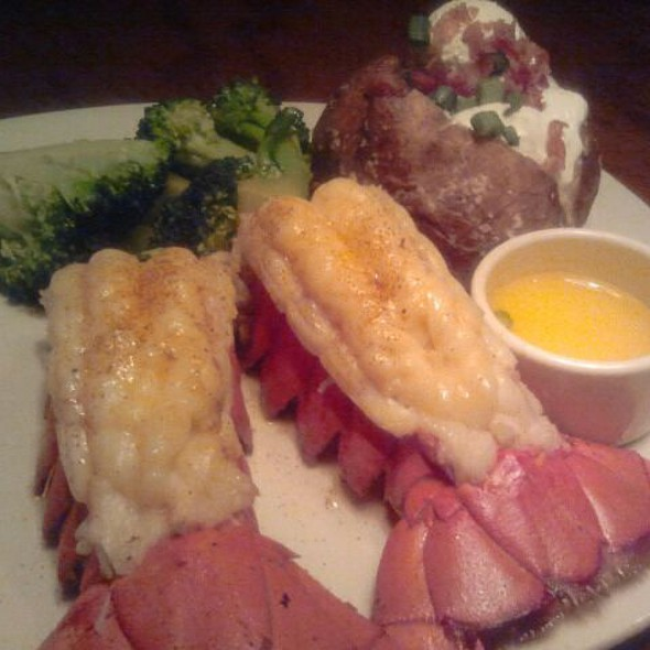 Grilled Lobster Tails, Lemon Potato, Wilted Greens, Oscar Hollandaise @ Outback Steakhouse