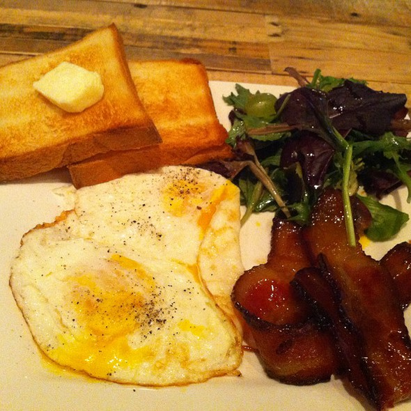 2 Eggs with House-Cured Maple-Glazed Bacon, Greens, and Freshly-Baked Brioche