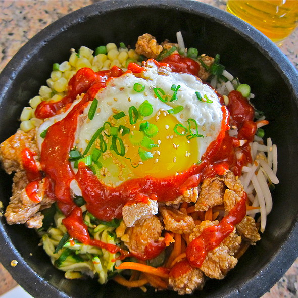 dol sot bi bim bap/ <signature hot stone rice bowl served at 500°>/ seasonal vegetables/ sunny side up organic egg/ steamed white rice/ fried chicken @ Stone Korean Kitchen
