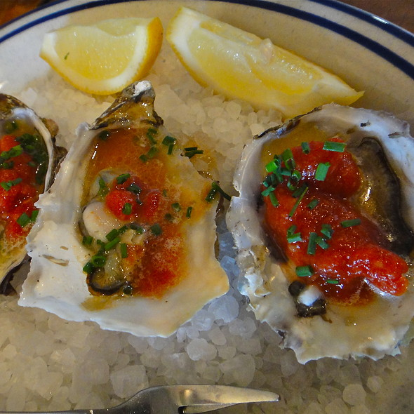 BBQ Oysters/ local oysters/ grill-poached & finished with our very own secret BBQ sauce/ lemon/ chives @ Fish