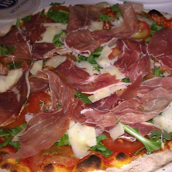 Pizza Silvio & Gabriele / Hand tossed crust with prosciutto, arugula, sliced tomatoes, sliced parmigiano reggiano, and mozzarella. @ Pizza DOC