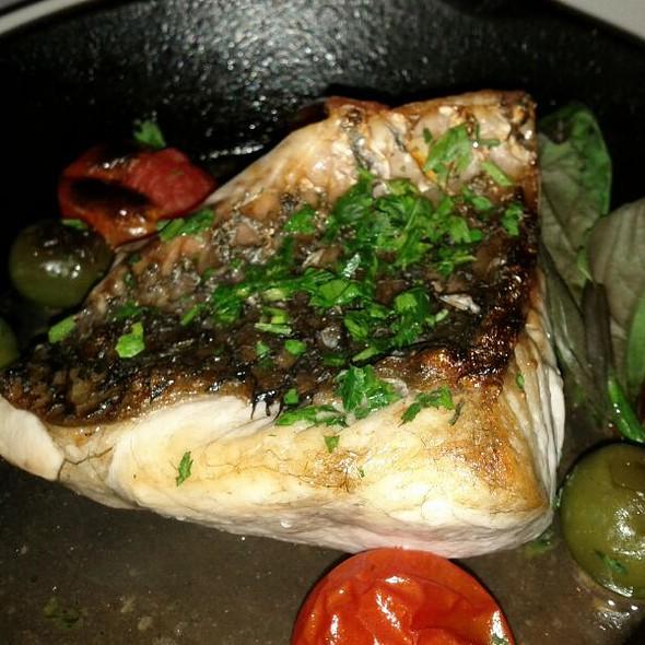 Wood fired Cone Bay Ocean barramundi fillet hotpot, cherry tomato, Sicilian olives, basil @ Grappa Ristorante & Bar