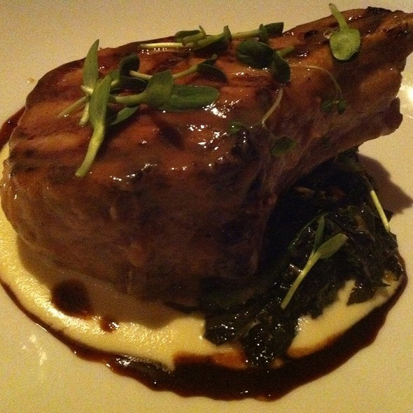 Heritage Pork Chop With Parsnip Puree And Kale - Luma on Park, Winter Park, FL
