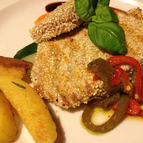 Grilled tuna steak coated in seasame seeds served with cauliflower and capsicum fillets  @ San Martino Restaurant