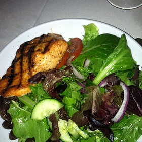 Grilled Salmon Over Traditional Salad