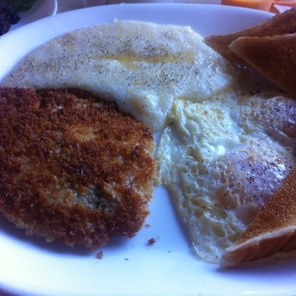 Talapia, Grits, Two Over Easy Eggs  @ Breakfast Club