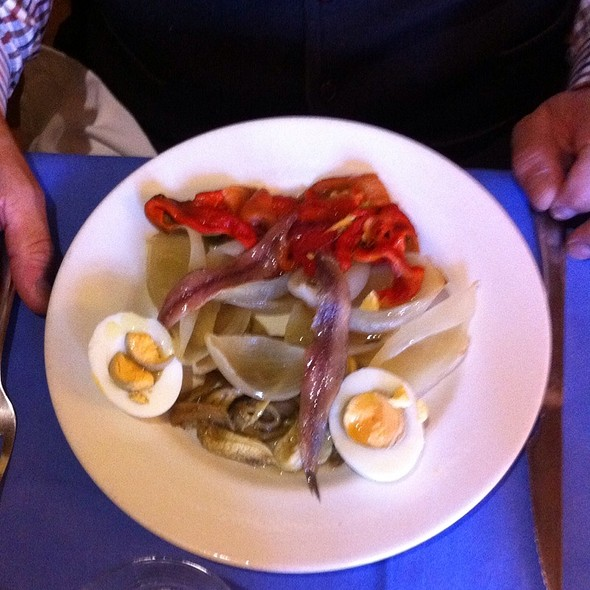 Salad With Anchovies And Onions And Pickled Red Capsicums