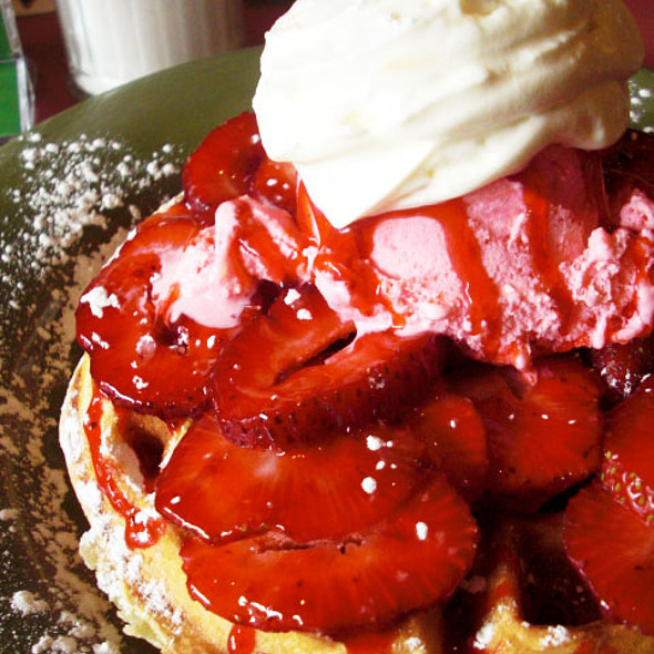 Belgium Waffle topped with Strawberries and Ice Cream @ Just Desserts Cafe