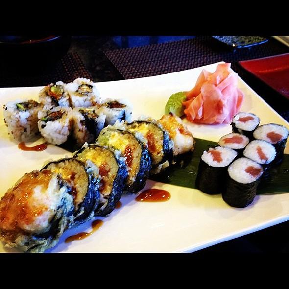 in celebration of alex starting spring break,he & i are logging in some sushi time. @ Kura Japanese Restaurant