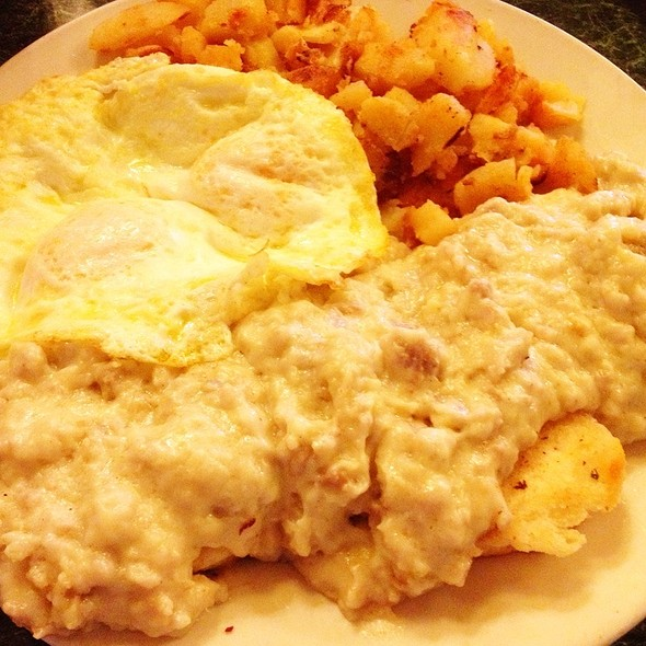 Sausage Gravy And Biscuits With Homefries And Two Eggs Over Easy
