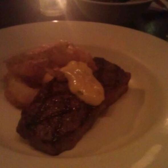 Char-grilled Angus sirloin steak, onion rings & tarragon butter sauce  @ Floriditas