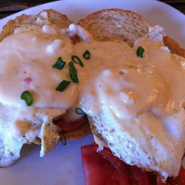 Open Faced Croissant With Over Easy Eggs, Black Forest Ham And Cheddar Cheese Sauce @ Inn Above Onion Creek Bed and Breakfast