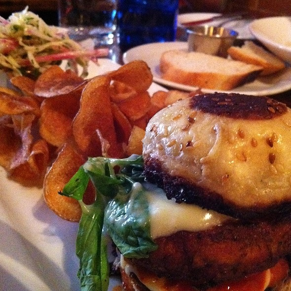 Fish Burger With House Made Kimchi And Aioli With Potato Chips And Salad @ Whalesbone Oyster House The