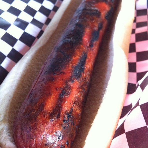 1/2lb Grilled Hot Dog @ Firebird Rotisserie & Sportsbar