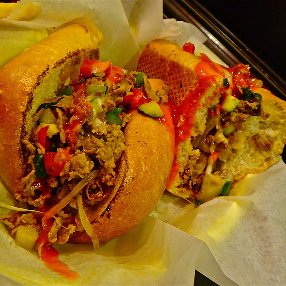 North Beach Cheese Steak Sando/ Steak/ spinach/ bell peppers/ onion/ zucchini/ spicy Buffalo hot sauce @ Buster's Cheesesteak