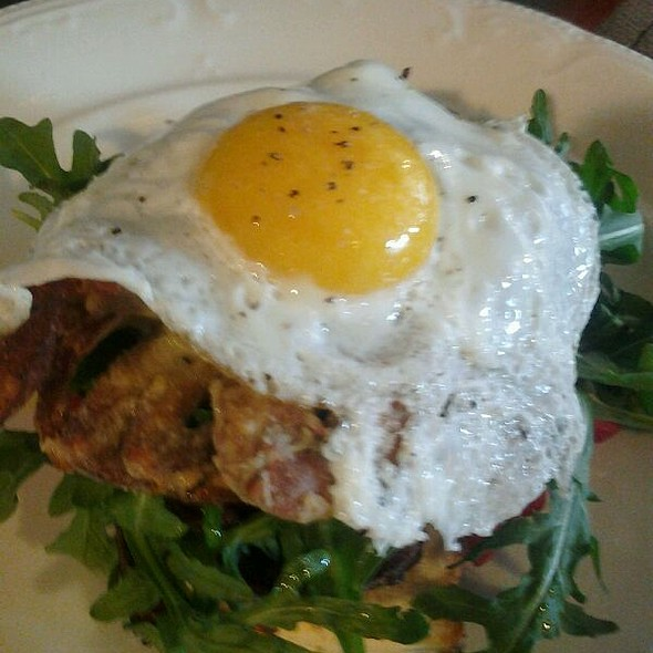 Open faced soft shell crab sandwich with fried egg and apple smoked bacon - The Village Cork, Denver, CO