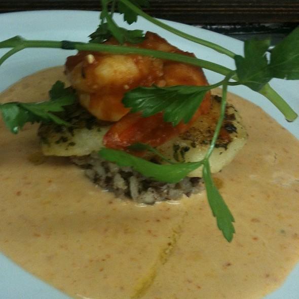 Pimenton Braised Sea Bass With Shrimp Piri Piri  Black Sausage Risotto Roasted Red Pepper Touriga Sauce @ Cafe Margaux Restaurant