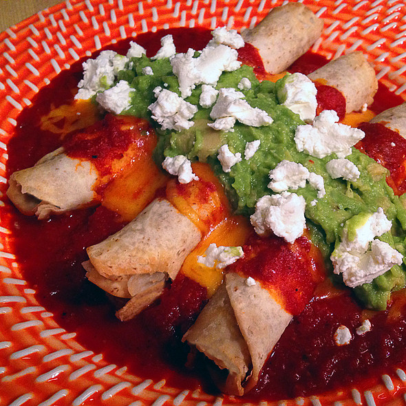 Crispy Flautas Stuffed with Chipoltle Chicken and topped with Hot New Mexico Chili Sauce, Cheddar Cheese, Guacamole, and Queso Fresco @ Castle Barrymore (Home)