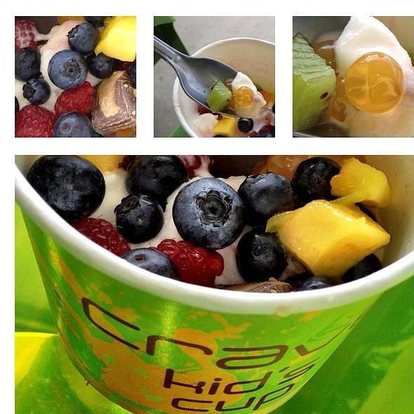 Pomegranite Frozen Yogurt With Fruit Toppings @ Crave Frozen Yogurt