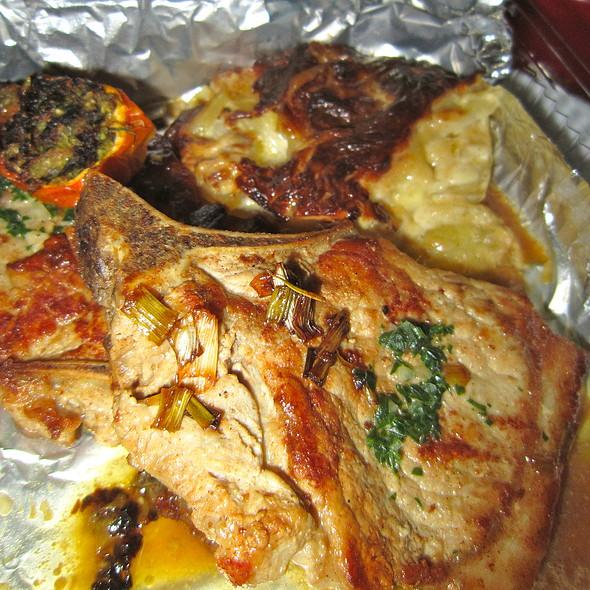 Pork Chop w/ Garlic Herb Butter & Potato Gratin @ Tymad Bistro