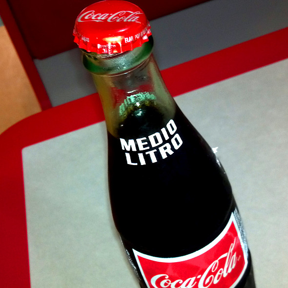 Coca Cola in a Latino Bottle