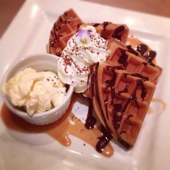 Belgian Waffles With Choclate Ganache, Caramel Sauce, Whipped Cream, And Vanilla Icecream