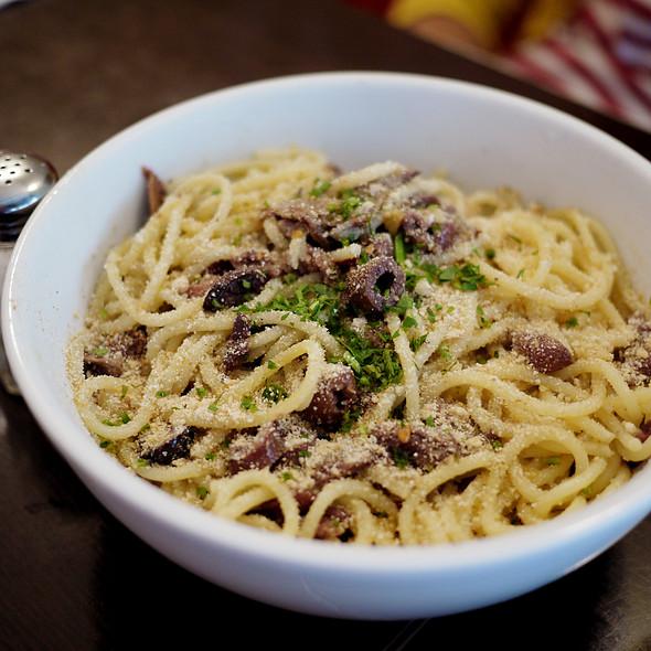 Spaghetti w/ Anchovies, Black Olives and Garlic Bread Crumbs - Fiat Cafe, New York, NY