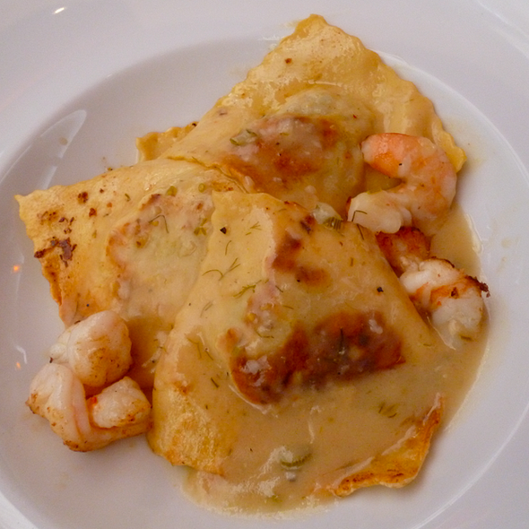 Ravioli filled with prawn and caramelised leeks with a creamy citrus bisque @ Ca de Vin