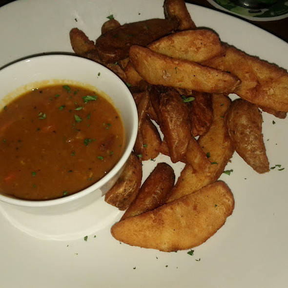 Chips And Curry Sauce @ Fado Irish Pub
