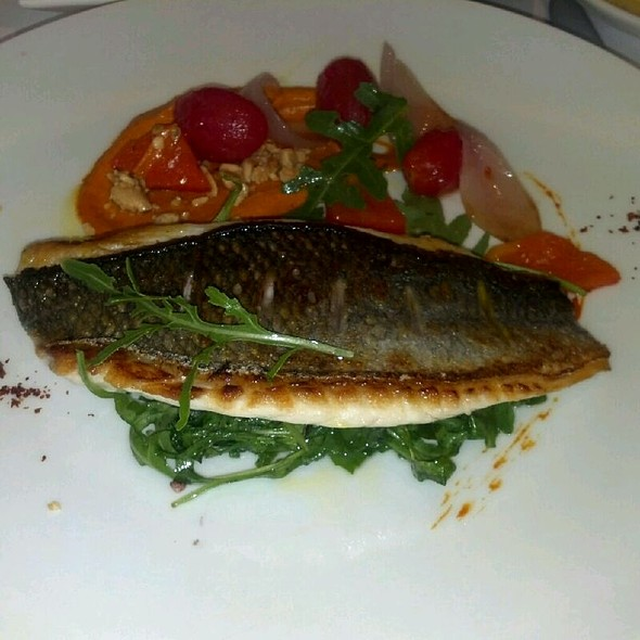 Roasted Daurade White Fish Stuffed With Tomato, Anchovies, In A Spanish Cherry Wine Sauce                             @ Boulud Sud