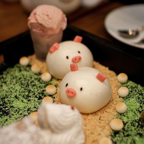 "Signature ""Piggy Face"" sesame bun and ""Totoro"" marsh-malllow arranged in an edible garden setting and served with ice cream"