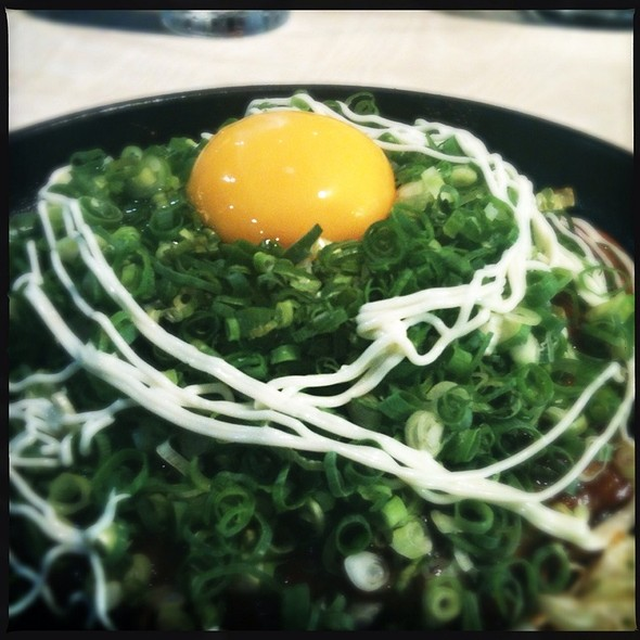 Hiroshima Style Okonomiyaki With Green Onion And Yolk