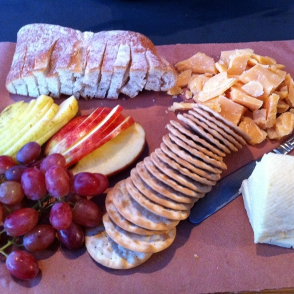 Aged Gouda and Doux de Montagne cheese with bread and fruit @ Lincoln Street
